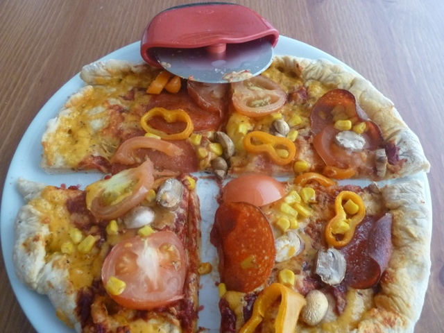 Homemade pizza and oxo good grips cutter