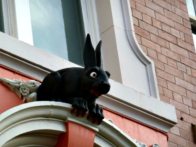 A sideways close up of the vampire rabbit over the back door of the cathedral buildings in Necastle