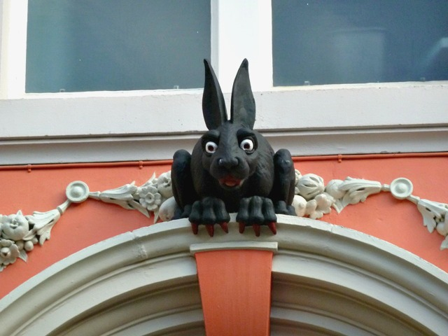 A front close up of the vampire rabbit perching on the back door of the cathedral buildings in Newcastle
