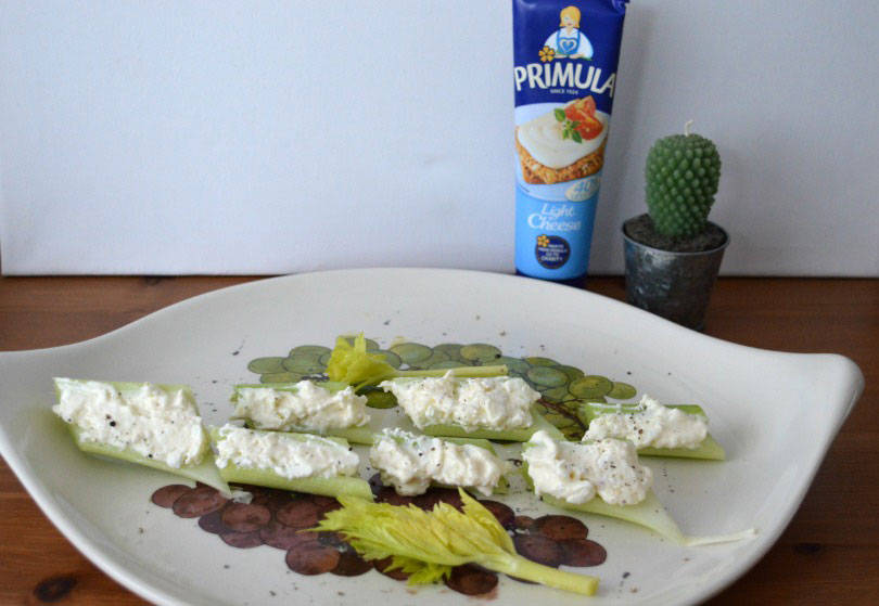Cheese stuffed celery sticks with horseradish