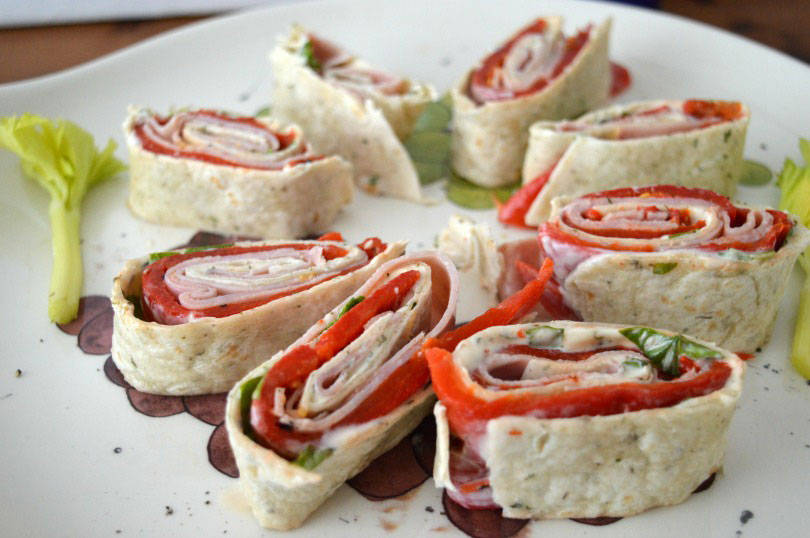 Pinwheel sandwiches made from cheese ham and red peppers