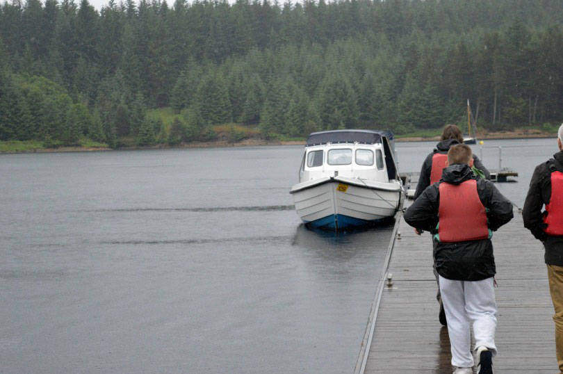 Boarding the motorboat for the osprey tour of kielder water