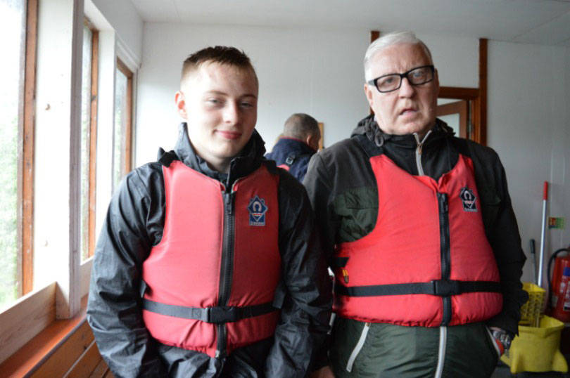 Donning life jackets for the motorboat tour of kielder