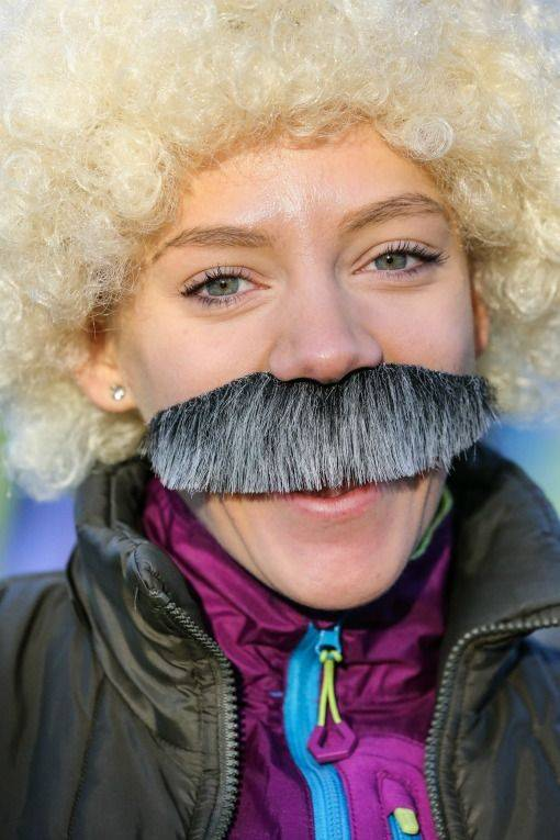 Morunning woman with moustache