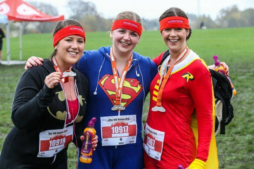 Morunning ladies dressed as superwoman