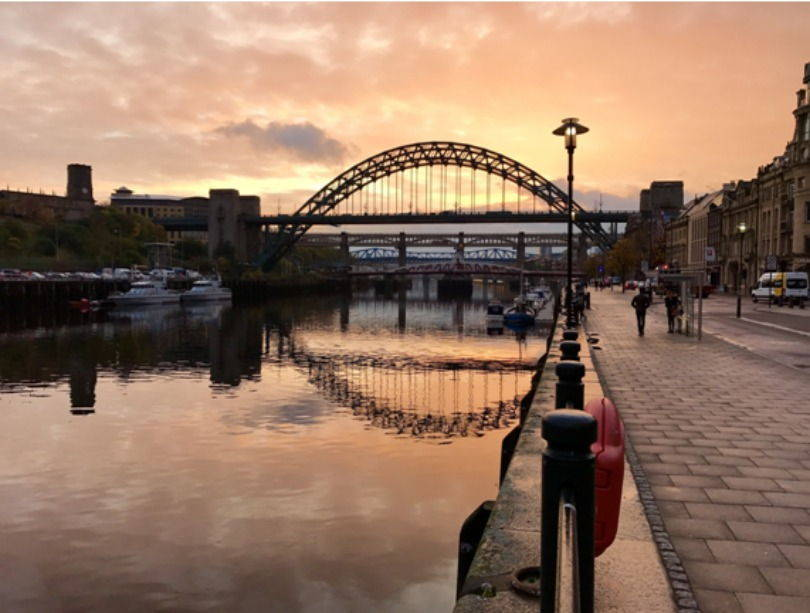 The view along the Newcastle quayside at sunset