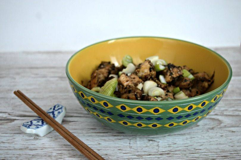 Sesame Chicken in a bowl with chopsticks