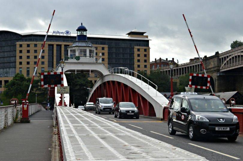 Walking across the swing bridge Newcastle