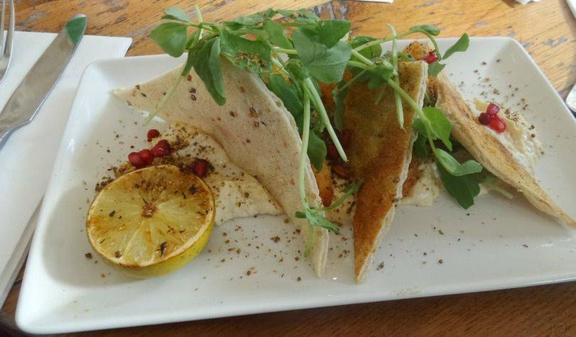 Breaded Halloumi with Hummus, Dukkah, House Flatbread & Pomegranate starter at Revolution Newcastle