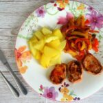 Spanish pork with sweet and sour peppers and saffron potatoes