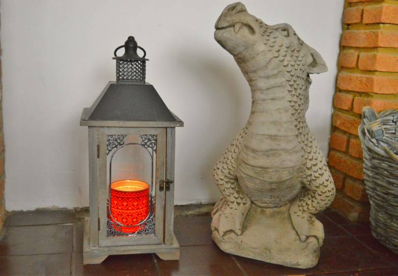Candle in a lantern on fireplace
