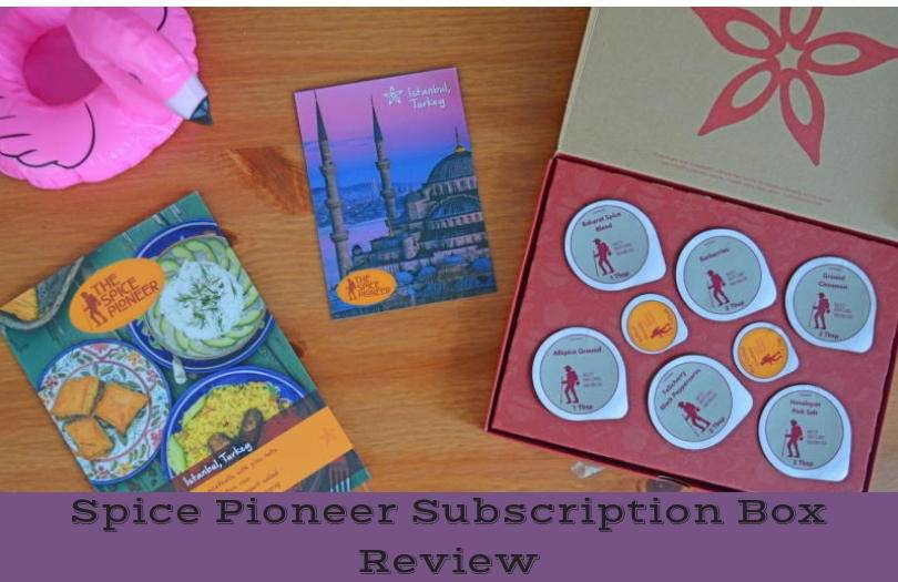 The contents of the spice pironeer subscription box shown on a wooden background
