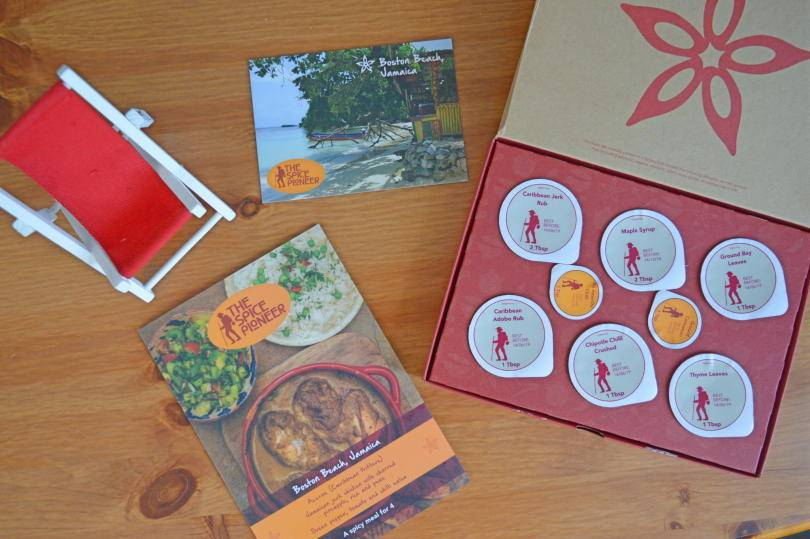 The contents of the spice pioneer spice subscription box shown on a wooden background.