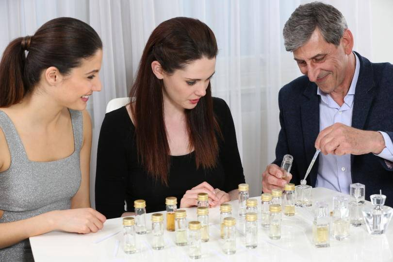 People blending perfume
