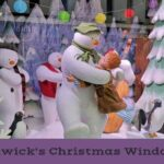 The snowman dancing with boy in christmas window display