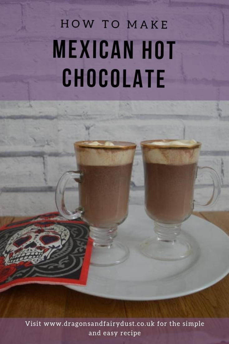 Two tall glass cups of hot chcolate with cream on top on a plate