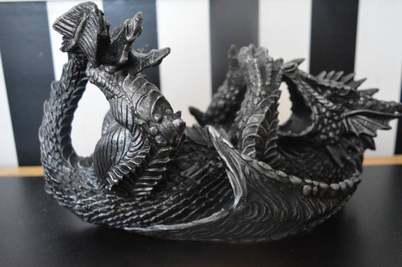 dragon wine bottle holder on a table