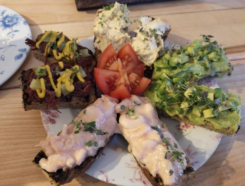 Open sandwiches on plate for afternoon tea at Revolution