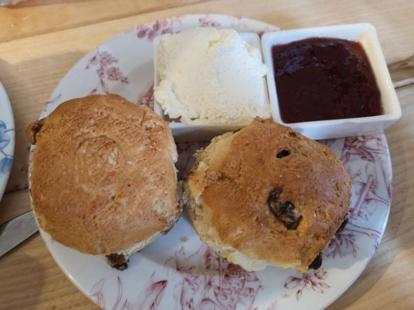Scones on plate with cream and jam in pots for afternoon tea at Revolution Newcastle