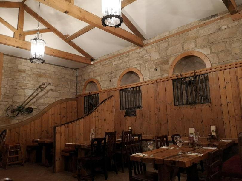 Inside Stables restaurant, the tables and overhead beams