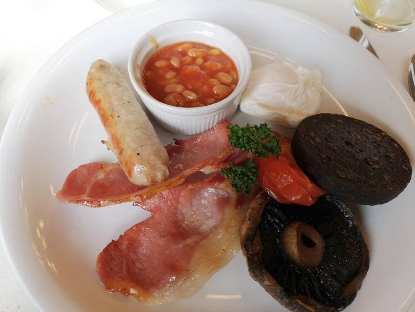 Bacon, egg, sausage, beans and black pudding on a plate. Breakfast at Beamish Hall Hotel