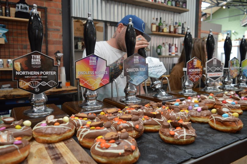 Beer pumps at Tyne Bar Brewery with doughnuts from R Place in front
