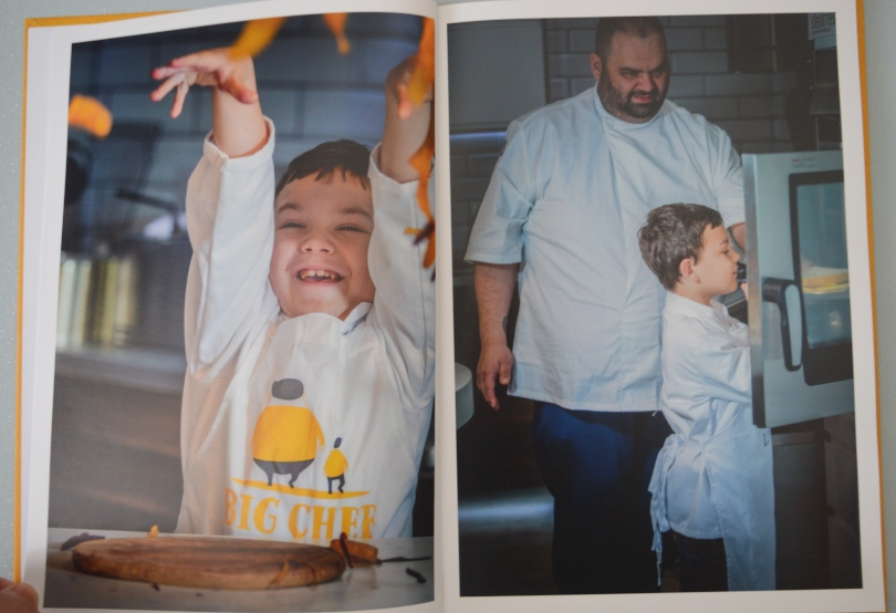 Picture from the inside of big chef mini chef cookbook showing the chef and his son