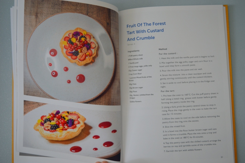 Picture from inside a cookbook of fruit of the forest tart