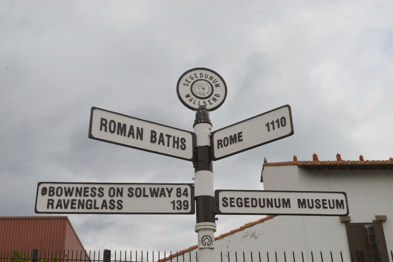 Signpost beside Segdumum Roman fort showing distance to Rome