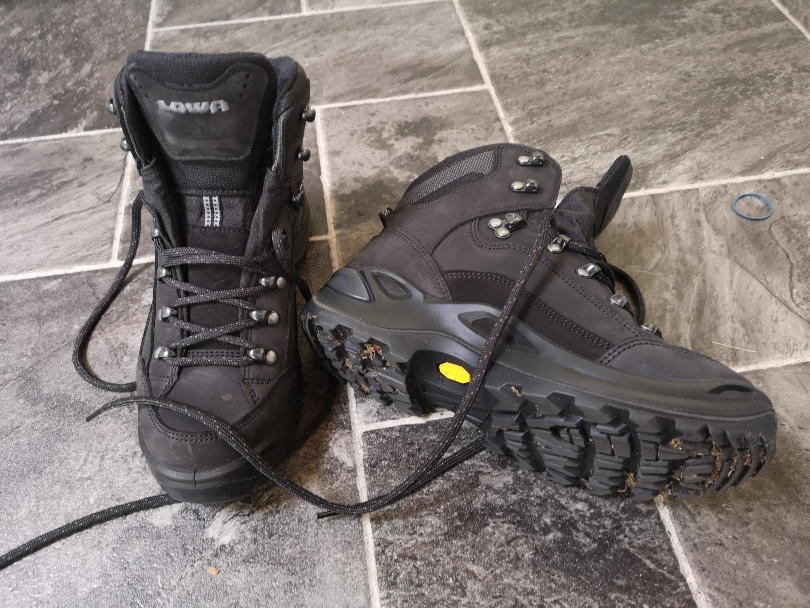 Lowa renegade walking boots on tiles with one tipped so you can see the sole