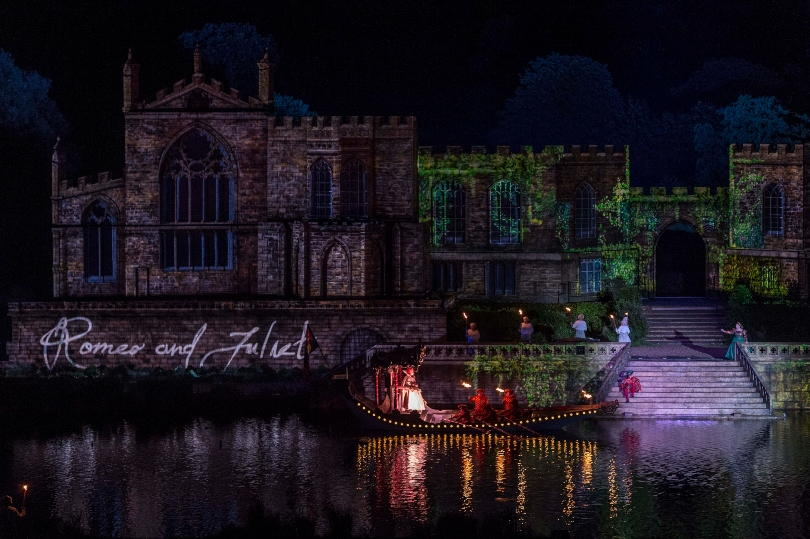 Shakespeares barge at Kynren on the river passing in front of the castle