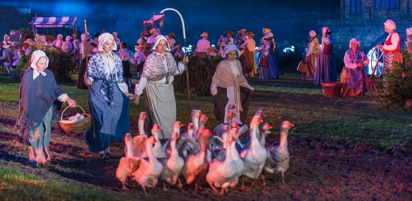 Women herding geese at Kynren
