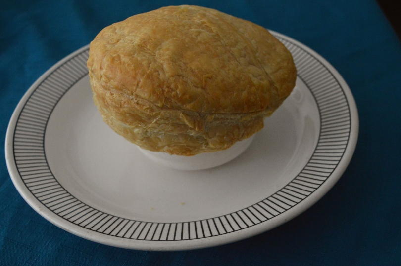 cooked steak and ale pie on a plate