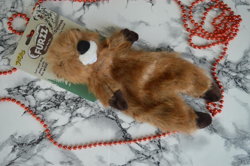 A plush dog toy on a marble backgound