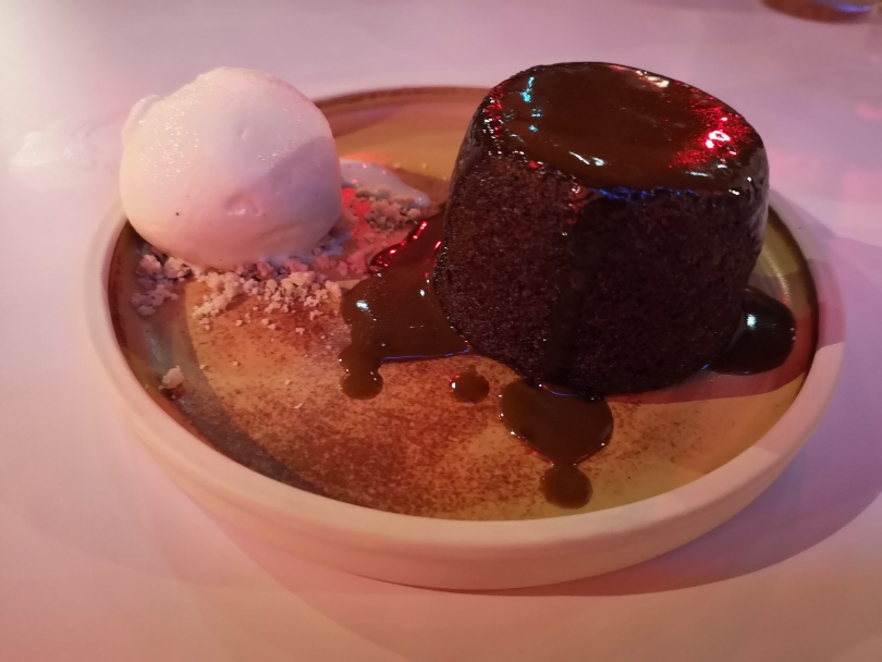 sticky toffee pudding on a plate with ice cream
