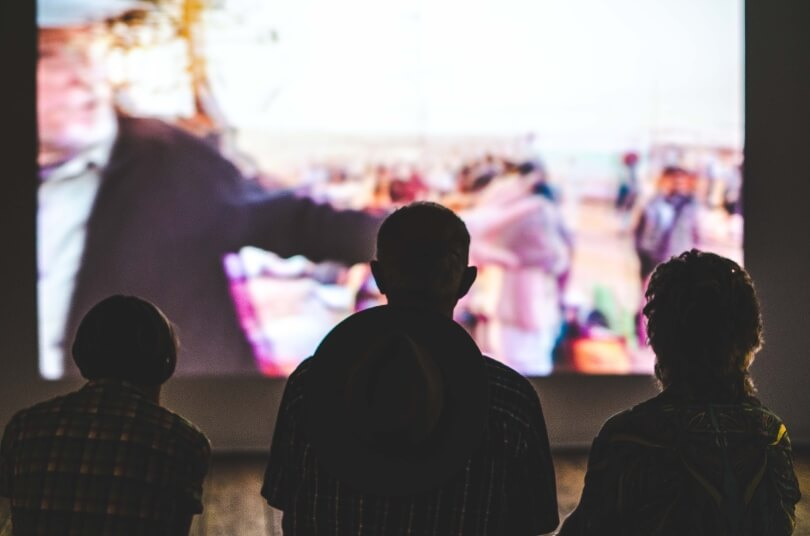 People in front of tv screen