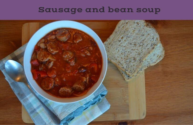 sausage and bean soup in a bowl on a table